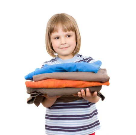 little girl with a pile of T-shirts