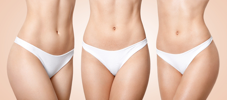Photo pour Set of female with perfect body, wears white panties, has soft skin, fit stomach, slender legs wears white underwear, isolated over beige background. Women, dieting, healthy lifestyle concept - image libre de droit