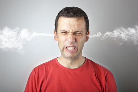 Stress and anger, angry upset man with head pressure and smoke coming out from his ears