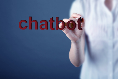 Chatbot and future communication concept. Hand holding mobile phone with chatbot conversation