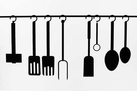 Photo pour Set of kitchen utensils painted as silhouette on a wall - image libre de droit