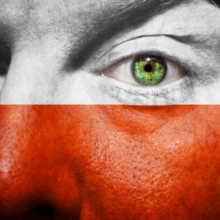 Polish flag painted on a man's face to support his country Poland