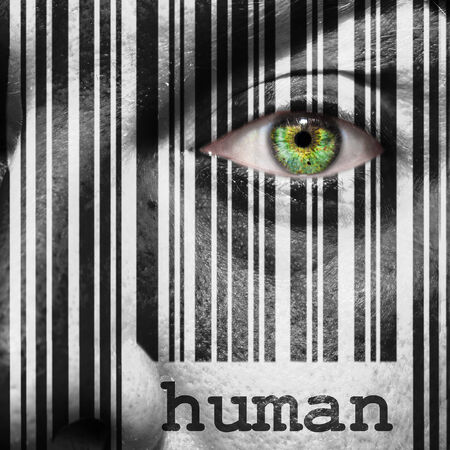 Barcode with the word human as concept superimposed on a man's face