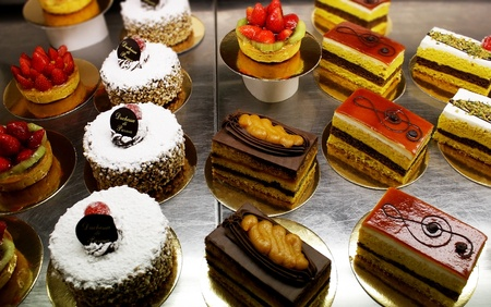A variety of Italian decorated  pastries, cakes and slices of cakes