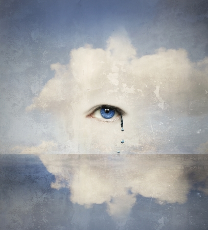 Fantasy concept of a human eye crying in the clouds