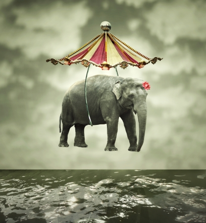 Fanciful and artistic image that represent a flying elephant with circus tent above the water
