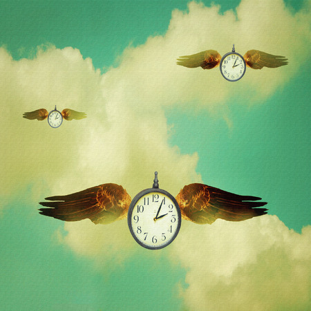 Illustrative colorful image of three clocks with wings flying in the clouds