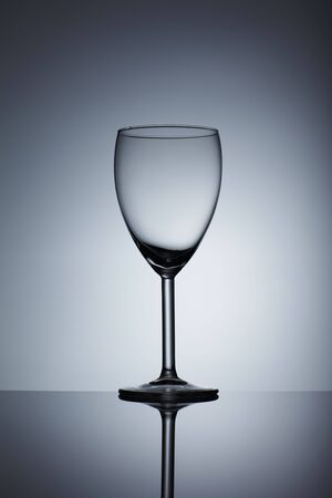 Empty wine glass isolated over background