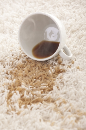 A glass of spilled coffee  on brand new carpet is sure to leave a stain.