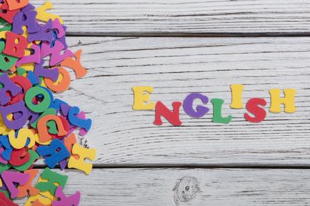 Photo pour colorful words on white wooden background - image libre de droit