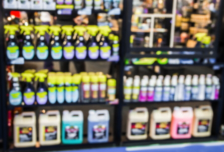 abstract blurred  car care products store.