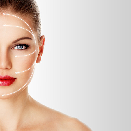 Skin care and rejuvenation therapy on pretty woman face. Close-up portrait of attractive Caucasian female model with red lips isolated over white background.