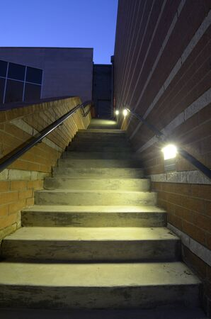 An exterior stair case with lighting