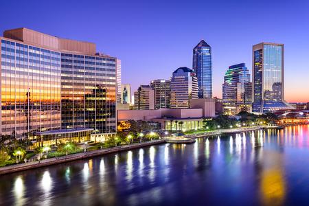 Jacksonville, Florida, USA city skyline on St. Johns River at dawn.