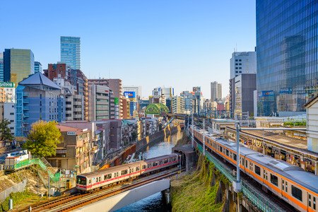 JANUARY 2, 2013: Trains pass over the Kanda River in the Ochanomizu district of Tokyo.