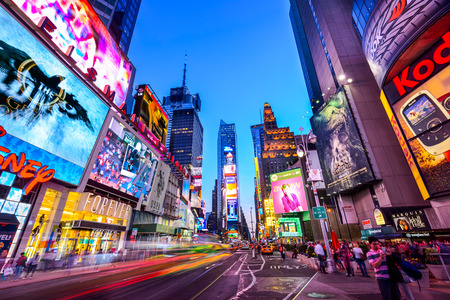 NEW YORK CITY - APRIL 9, 2013: Times Square crowds and traffic at night. The site is regarded as the world's most visited tourist attraction with nearly 40 million visitors annually.