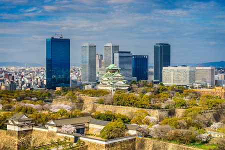 Osaka, Japan city skyline at the castle and business park.
