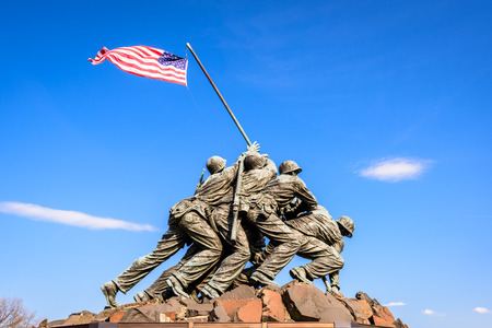 WASHINGTON, DC - APRIL 5, 2015: Marine Corps War Memorial at dawn. The memorial features the statues of servicemen who raised the second U.S. flag on Iwo Jima during World War II.