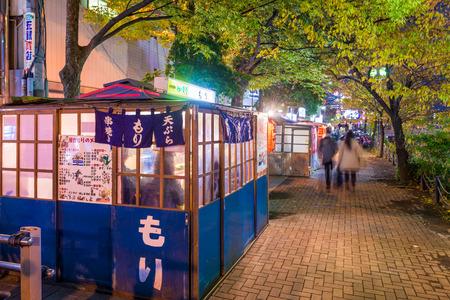 FUKUOKA, JAPAN - DECEMBER 5, 2015: Food stands, locally called yatai line Nakasu Island.