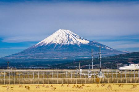 Photo pour Mt. Fuji in Japan with farmland and passing train. - image libre de droit