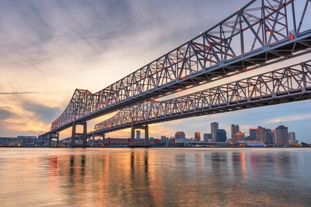 Photo for New Orleans, Louisiana, USA at Crescent City Connection Bridge over the Mississippi River at dusk. - Royalty Free Image