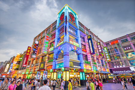 Photo for GUANGZHOU, CHINA - MAY 25, 2014: Pedestrians pass through Shangxiajiu Pedestrian Street. The street is the main shopping district of the city and a major tourist attraction. - Royalty Free Image