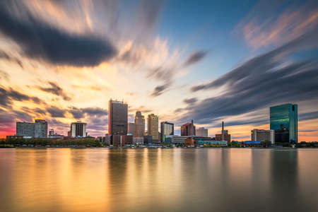 Photo for Toledo, Ohio, USA downtown skyline on the Maumee River at dusk. - Royalty Free Image