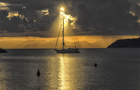 View of boat crossing the sun glitter