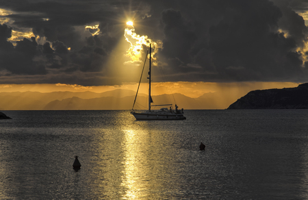 View of sailer crossing the sun glitter