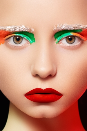 Photo for High fashion and beauty portrait photography. Beautiful girl model face with creative bright makeup like a doll, rainbow eyes and red lips make-up  - Royalty Free Image