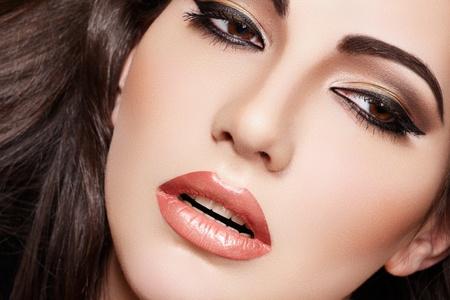Oriental style. Sensual arabic woman model. Beautiful clean skin, saturated makeup. Bright eye make-up and dark eyeliner