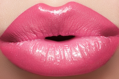 Sweet kiss  Sexy pink wet lip makeup  Close-up of beautiful full lips