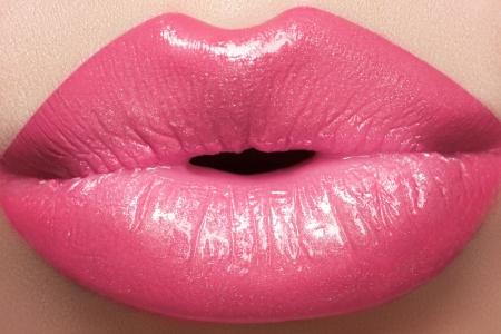 Sweet kiss  Sexy pink wet lip makeup  Close-up of beautiful full lips