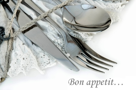 Table fork and knife in a napkin of medieval style