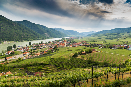 Scenic View into the Wachau with the river Danube and the market town Weissenkirchen in Lower Austria. Famous UNESCO cultural landscape known for its wine.