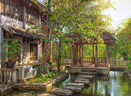 asian tropical garden with traditional architecture, Vietnam