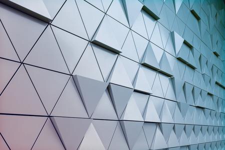 Foto de Abstract close-up view of modern aluminum ventilated triangles on facade - Imagen libre de derechos