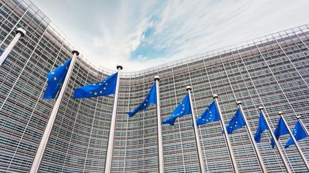 Photo pour The queue of steeples with blue flags of the European Union - image libre de droit