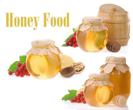 glass jar full of honey and stick isolated on white backgroundの写真素材