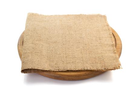 sack burlap napkin at cutting board on white background