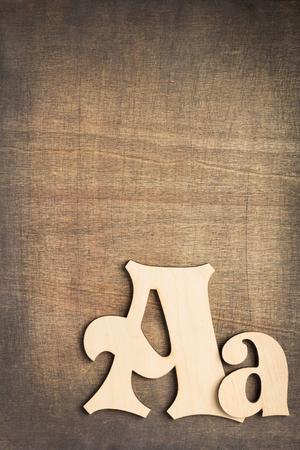 Foto de wooden letters at old background, top view - Imagen libre de derechos