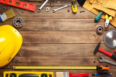 Photo pour set of tools and instruments at wooden table surface background - image libre de droit