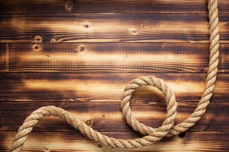Photo for ship rope at wooden background, plank board texture - Royalty Free Image