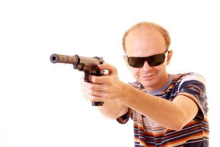 Young man aiming with gun isolated