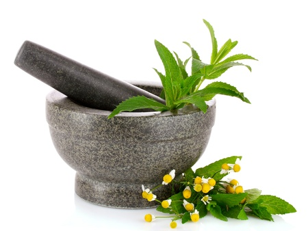 Photo pour stone pestle and mortar with chamomile and mint isolated on white - image libre de droit