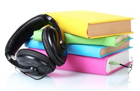 Headphones on books isolated on white