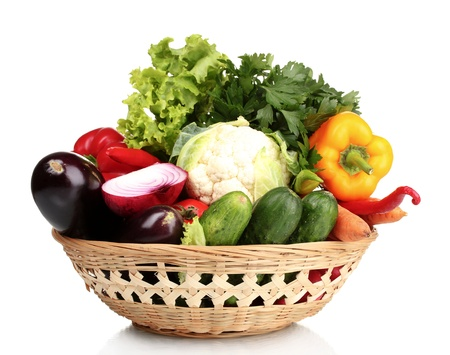 Fresh vegetables in basket isolated on whiteの写真素材