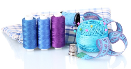 bright blue yarn, fabric and measuring tape isolated on white