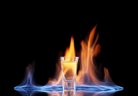 Photo pour Flaming vodca on black background - image libre de droit