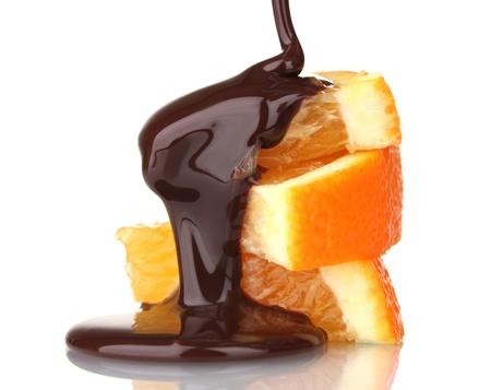 sliced ripe orange with chocolate isolated on white